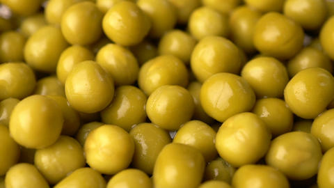 Green pickled peas rotate background Footage