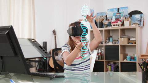 Cute teenager girl wearing a VR headset learning about DNA Footage