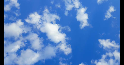 4k Fluffy White Clouds Moving Across Blue Sky. Camera Panning Across Cloudy Sky Live Action