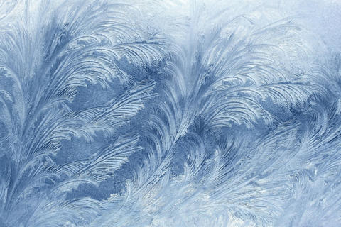 Winter drew an icy pattern on the window in the form of a flower .Texture or Fotografía