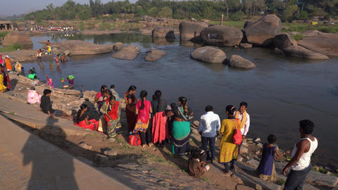 People are transported by boat to the other side of the river Footage
