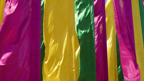 Waving multicolored flags in wind close up Archivo