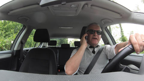 Caucasian Man Speaking On Mobile Telephone And Sitting In Car Footage