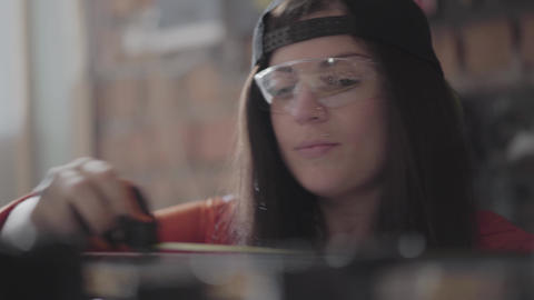 Portrait skill woman in a cap and protective glasses with pierced lip and ring Footage