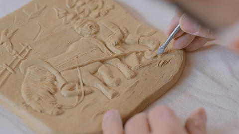 Potter making clay stamp picture Archivo