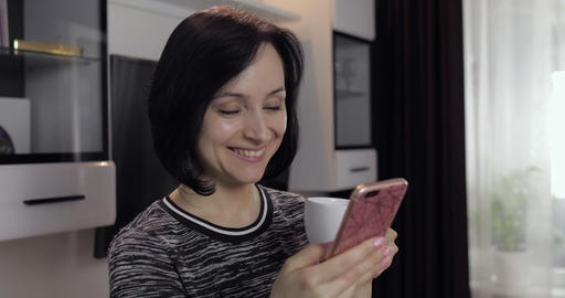 Woman having chat on social media using smartphone enjoying chatting to friend Footage