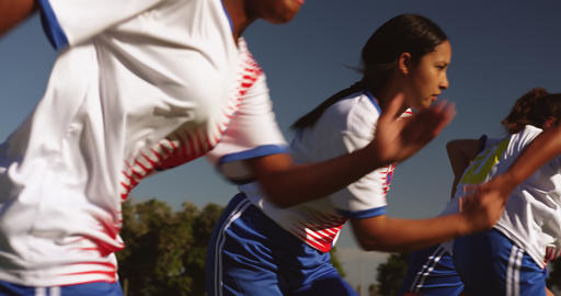 Female soccer team running while team captain gives instructions. 4k Live Action