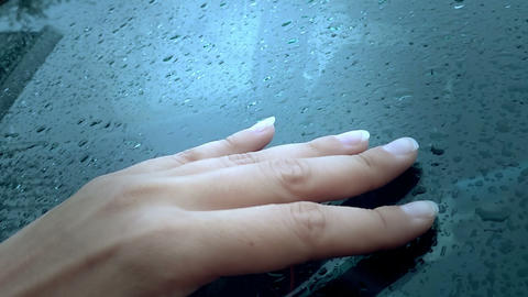 female hand touching glass with rain drops. tactile sensations Footage