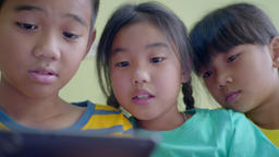 Closeup young children's using smart phone at home Footage