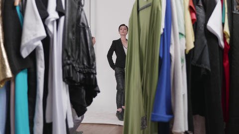 Shooting through a rack of clothes ready for the photo shoot Footage