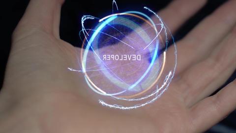 Developer text hologram on a female hand Live Action