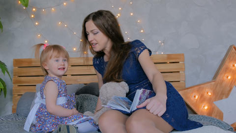 Portrait of funny little girl and her mother at home Footage