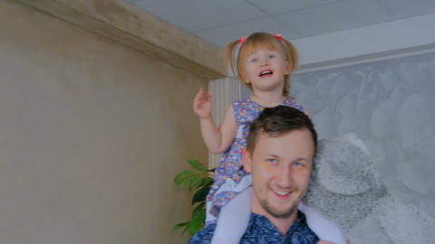 Portrait of funny little girl and her father at home Footage