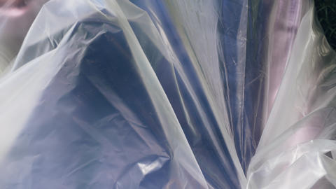 Woman inside a plastic bag. Concept of plastic pollution Footage