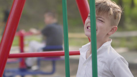 Young boy crying near the swing, kid hurt himself. Outdoor recreation Live Action