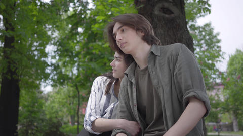 Portrait adorable young couple in casual clothes spending time together in the Footage