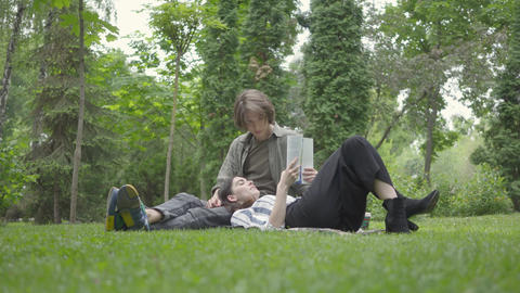 Portrait young couple in casual clothes spending time together outdoors, having Footage