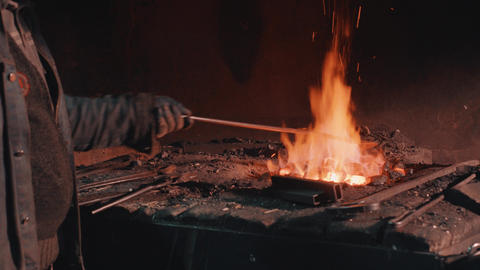 [alt video] Heating of metal detail in the fire