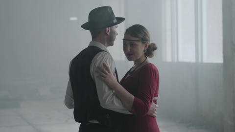 Portrait man in fedora hat, classical suits and woman in style cloth dancing in Archivo
