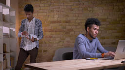 Closeup shoot of two ethnically diverse students studying together in the Footage