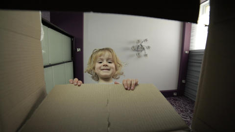 A little girl looks in the box to receive a surprise. The child opened a box Footage