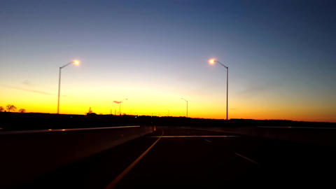 Driving Rural Countryside Road During Sunrise. Driver Point of View POV While Sun Rises on Horizon Footage