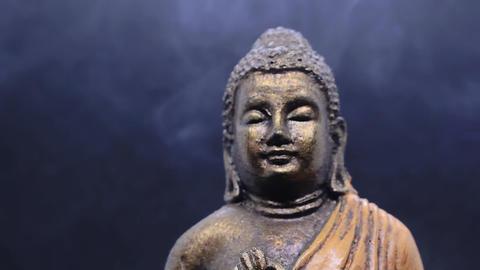 Meditating Buddha with incense smoke around Footage