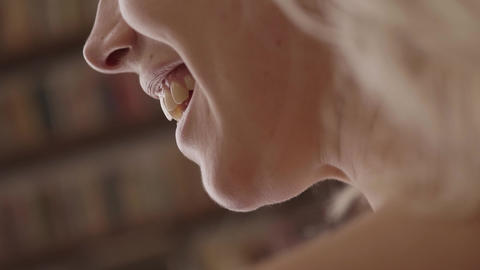 View of caucasian woman's face with focus on chin, mouth, teeth and lower jaw Live Action