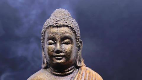 Meditating Buddha with incense smoke Footage