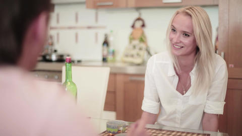 Brunette guy and blonde are having nice and friendly conversation in kitchen Footage