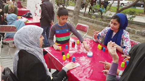 Tehran, Iran - 2019-04-03 - Street Fair Entertainment 23 - Children Stacking Live Action
