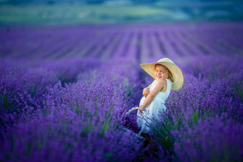 A Beautiful young girl outdoors portrait. kid in hat with basket flowers Photo