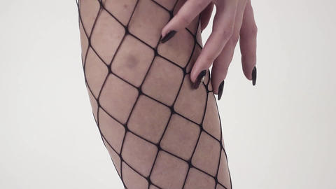 Demonstration of female's legs in black checkered stockings in black shoes Footage
