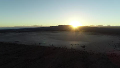 Aerial drone scene of dry plane desert, strange desertic geological formation at sunset. Barreal of Footage