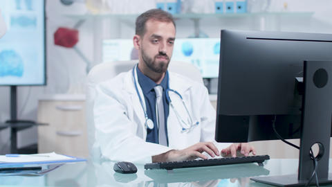 Tired doctor in his office is working Footage