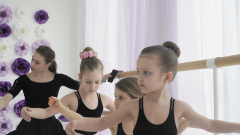 Close up of ballerinas are repeating the movements with the teacher Footage