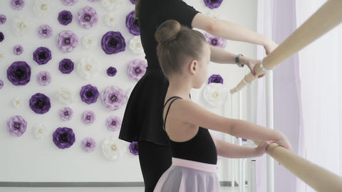 Cute ballerina repeats the movements with the teacher Footage
