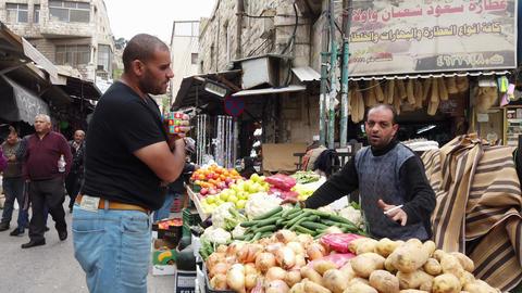 Amman, Jordan - 2019-04-18 - Street Vegetable Vendor Talks Bulk Purchase While Live Action