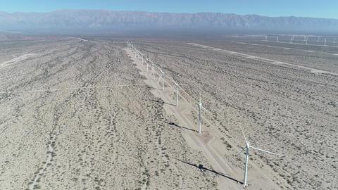 Aerial drone scene of wind field full of aligned wind turbines in Aimogasta, la rioja, Argentina. Footage