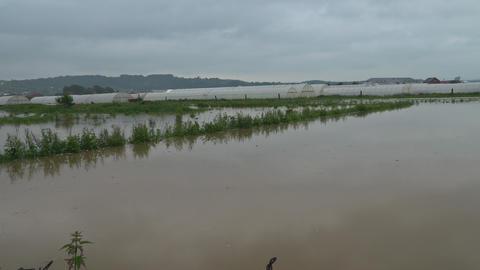 Rural farm flooding featuring farm house, on dry flooded fields Footage