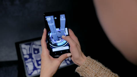 Woman using smartphone with architecture augmented... Stock Video Footage