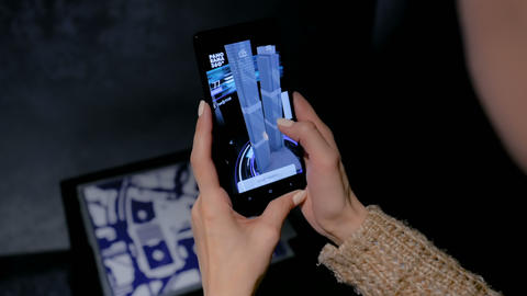 Woman using smartphone with architecture augmented reality app Footage