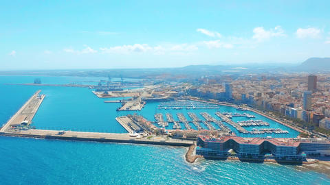 Aerial view on the city against the sea with a view of the mountain and fortress Footage