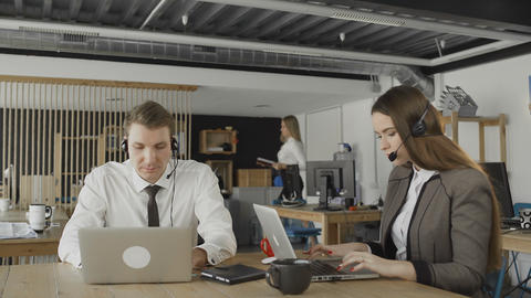 Customer service operators taking calls in busy call… Stock Video Footage