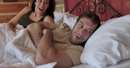 Enthusiastic happy smiling young couple in their early 30s or late 20s wake up from a good nights Footage