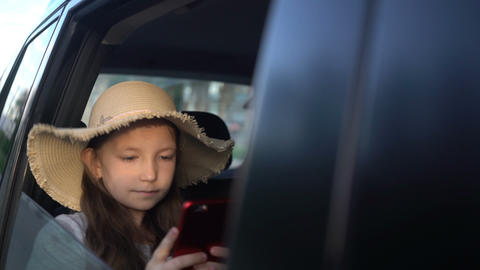 girl with straw hat sharing social media in a smart phone. road trip concept Footage