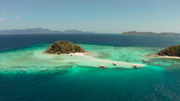 Small torpic island with a white sandy beach, top view Footage