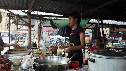 Sukhothai, Thailand - 2019-03-06 - Market Vendor Sells Soup For Lunch Live Action