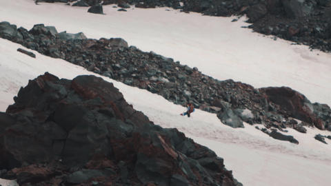 Extreme rider with snowboard climbing on mountain steep Footage