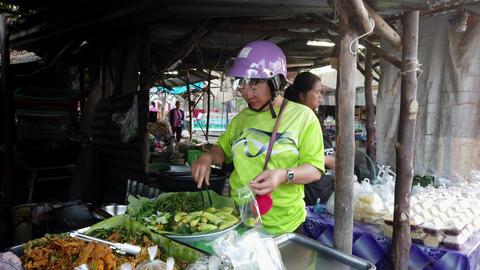 Sukhothai, Thailand - 2019-03-06 - Woman Buys Baby Corn From Market Vendor Footage